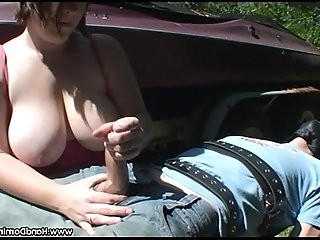shows off her huge tits in public handjob