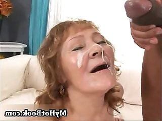Enjoy watching a redheaded granny getting her face