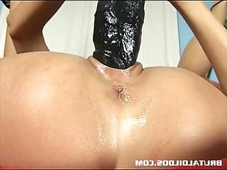 Gorgeous dark haired European babe fills her pussy with giant dildo