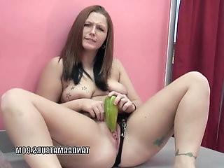 Curvy redhead Zoie Starr is masturbating her pussy with peppers