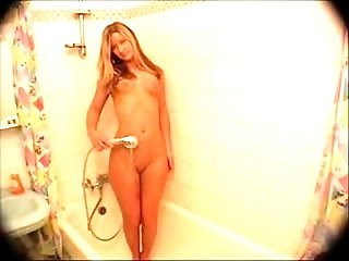 Cute young blonde in the shower
