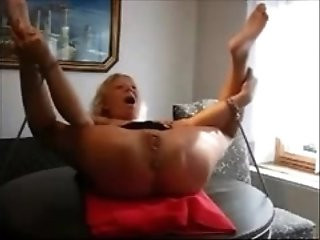 Mature Slave Tied To a Table and Fisted